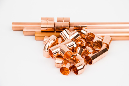 The copper pipes and armature on the white background