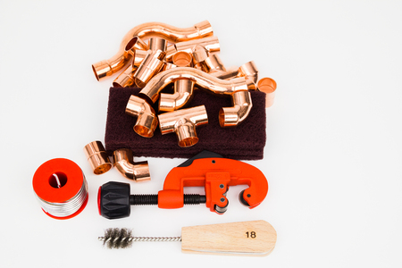 Tools to copper installation on the white background