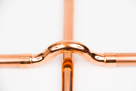 The part of copper installation on the white background Stock Photo