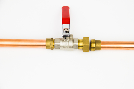 The ball valve and copper pipe on the white background