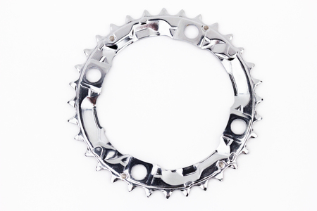 Part for bicykle - the chainring on the white background