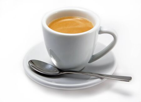 White small cup of fresh brewed espresso with a spoon