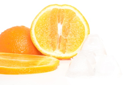 Sliced fresh orange and ice isolated on white photo
