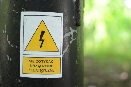 High voltage warning old sign against blurred background Stock Photo - 21387847