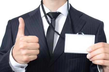 Young businessman with identification card isolated photo