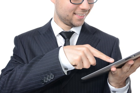 Young businessman with tablet isolated on white photo
