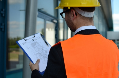 Portrait of a young engineer at work outdoors photo