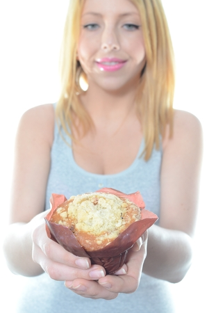 Young woman eating fresh salad isolated photo