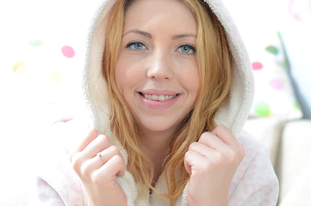 eyes hazel: Portrait of beautiful young woman in bathrobe