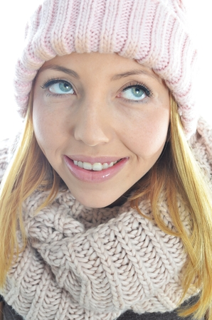 Young woman wearing winter clothing isolated photo