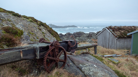 Old rusty gears,Standing on a rock by the sea. Stock Photo
