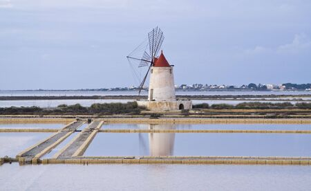 Typical windmill at the salt pond of Marsala, Sicily. Italy. photo