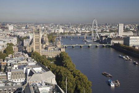 Aerial view on Houses of Parliament, London Eye and Westminster Bridge on Thames River. photo