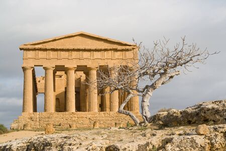 occupying: Ruins of Temple of Concord in Valley of the Temples in Agrigento (Akragas), Sicily. After Theseion in Athens, it is the best preserved Greek temple in the world.