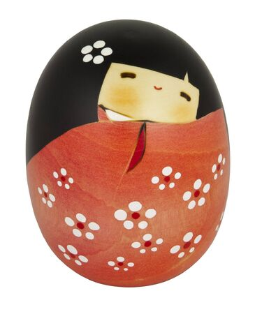 Wooden kokeshi doll handcrafted in Japan (cut-out on white background). photo