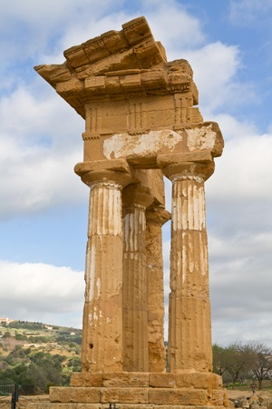 occupying: Ruins of Temple of Castor and Pollux in Valley of the Temples in Agrigento (Akragas), Sicily. Stock Photo