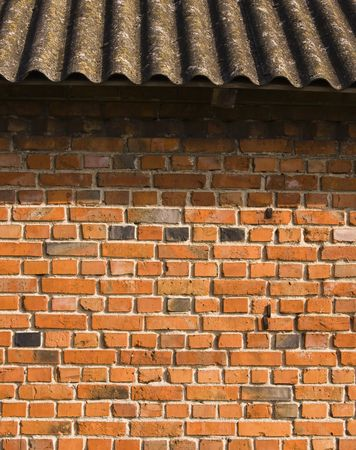 real brick wall with metal rusty holder, its a great tile abstract background