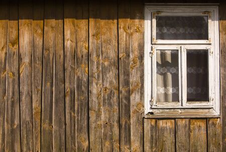 old vintage wooden wall with window of house in the village; arranged in stripes photo