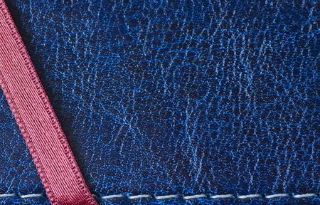 blue leather image from book cover with nice texture, white thread seam and red ribbon photo