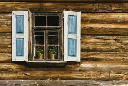 window with shutter and part of wooden wall old cottage polish house