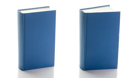 hardback: two blue hard-back standing books, one closed second ajar; isolated on white background Stock Photo