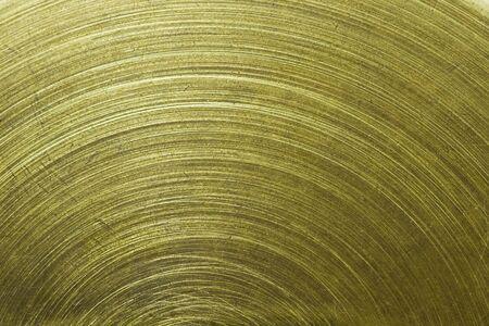 macro of Circular scratch on gold brass metal