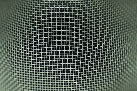 macro of metal mesh from stainer with limited focus photo