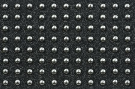 texture of artificial grey leather with regularly placed metal dot