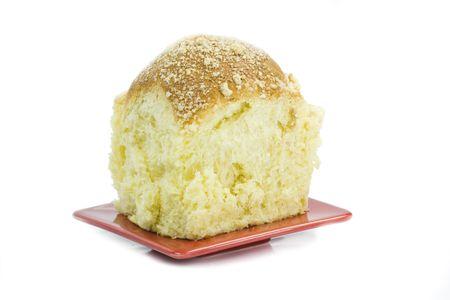 teacake: bun on red dish isolated on white background