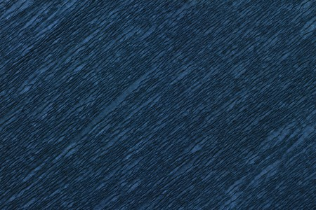 full frame close up of dark blue wrinkled crepe paper photo