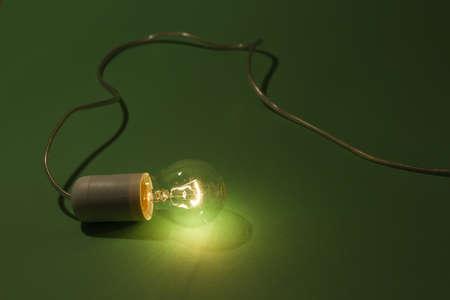lightbulb laying on green background Stock Photo - 11032169