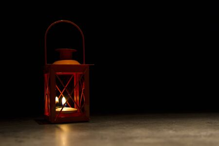 orange wind lantern standing isolated on black background Stock Photo - 13622469