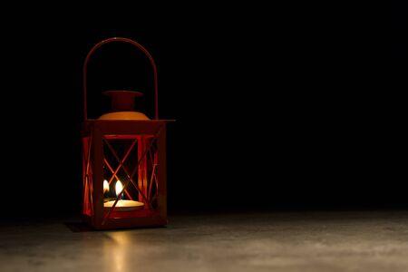 orange wind lantern standing isolated on black background Stock Photo - 13622469
