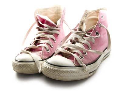 pair of pink worn-out sneaker isolated on white background Stock Photo - 16847851