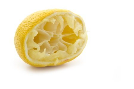 squeezed half yellow lemon isolated on white background Imagens