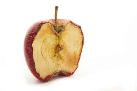 wilted rotten half of apple isolated on white background Stock Photo - 17032385