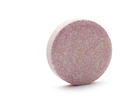 resolved: single vitamin soluble pill isoalted on white