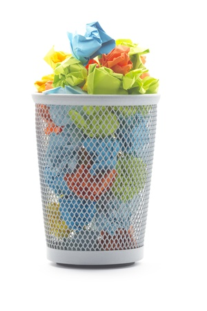 isolated office wastepaper basket with colourful crumbled paper ball Stock Photo - 17612720