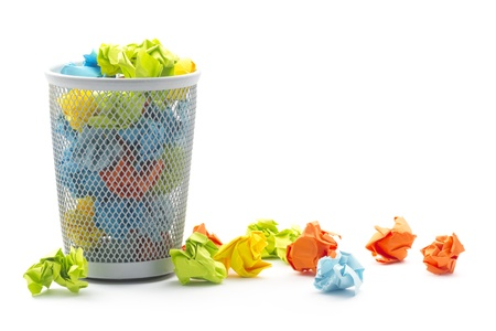 isolated office wastepaper basket with colourful crumbled paper ball
