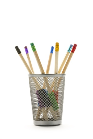 group of pencil with various colours rubber in basket isolated photo