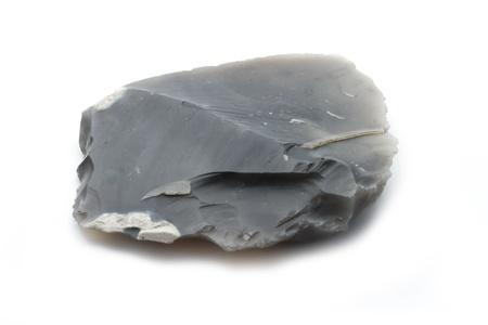 plain dark single piece of flint isolated on white