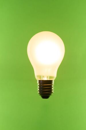 lit matte light bulb isolated on breen screen Stock Photo - 18247471