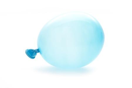 single blue small balloon macro isolated on white photo