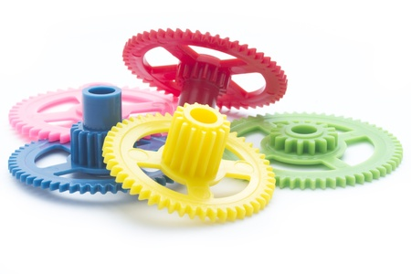 arrangment ofmulticolor plastic cog gear isolated on white
