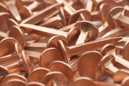 full frame background of copper nails in mess photo