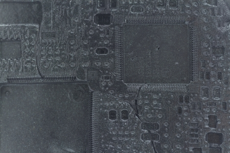 printed circuit imprint in black plasticine background, concept of obsolete electronic, view like fossil photo