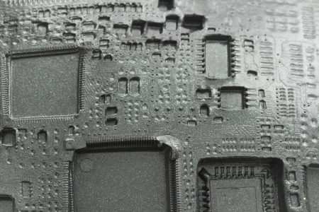 printed circuit imprint in black plasticine background, concept of obsolete electronic, view like fossil