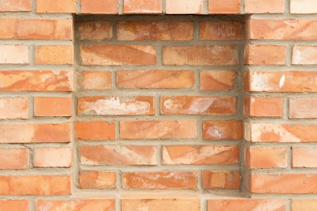 recess: full frame background of brick red wall with recess