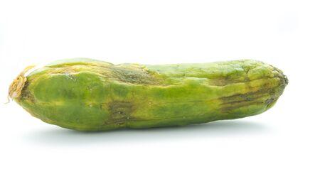 perish: single rotten wilted cucumber isolated on white Stock Photo