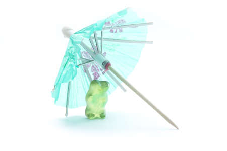 concep: gum bears under drink umbrella isolated vacation concep Stock Photo